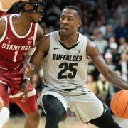 McKinley Wright IV driving to the basket against Stanford