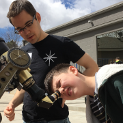 Kid looks through telescope as part of CU-STARs project