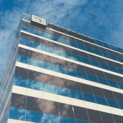 A CU building reflects clouds in the sky