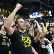 Buffs fans cheer at a men's basketball game CSU
