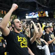 Fans cheer on the men's basketball team