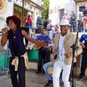 Musicians perform outside in Cuba