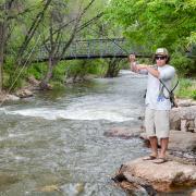 Ryan Watson fishes in Boulder Creek