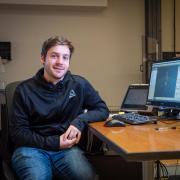 Joshua Tacca at computer