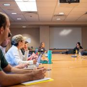 Leslie Blood leads an in-person seminar for graduate students pre-COVID