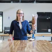 Madalyn Kern stands in the Idea Forge with a prosthetic leg