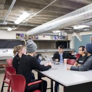 Students chat over coffee at the Idea Forge