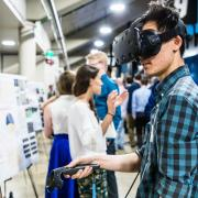 Person using VR headset at CU Engineering Projects Expo