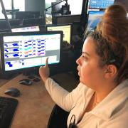 A CU Boulder police dispatcher is seen working with the upgraded communications system