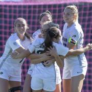 CU women's soccer team hug in celebration