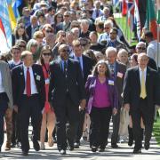 67th annual CWA procession through international flags