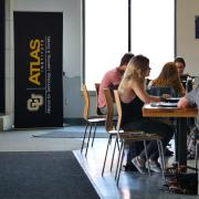 Students studying, on laptops in ATLAS Center lobby