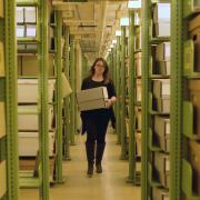 CU Boulder archivist Jane Thaler carries a box of CWA archives