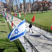 International flags line pathway during Conference on World Affairs