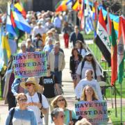Students hold 'Have the best day ever!' signs during 2015 CWA procession