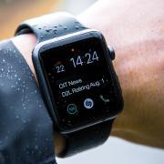 A notification appears on a wrist watch