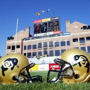 CU football helmets on Folsom Field in front of Dal Ward