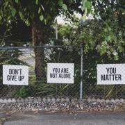 Signs that read 'Don't give up' 'You are not alone' 'You matter'