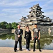 Danielle Salaz of the Center for Asian Studies with a business leader and student in Japan