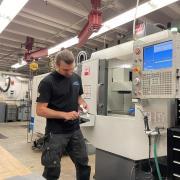Researcher working on machine
