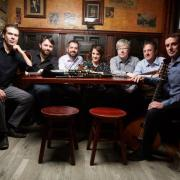 Irish folk ensemble Danu sitting in a pub