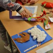 kids create book in the Literacy and Media Lab