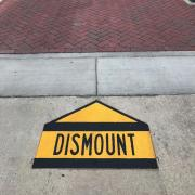Dismount sign on campus