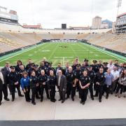 CU Police department gather at Folsom Field for a goup photo during the swearing-in ceremony for new CU Boulder Police Chief Doreen Jokerst in 2018. (Photo by Glenn Asakawa/University of Colorado)