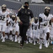 Karl Dorrell leading the Buffs onto the field against Arizona