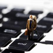 Image of a old man figurine on a keyboard