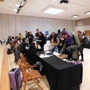 Students get information at a student job fair.