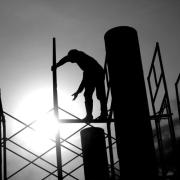 A person stands on scaffolding.