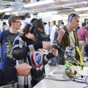 Person wears virtual reality goggles as part of engineering expo project