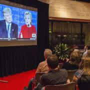 A crowd tunes in for a televised debate between Hillary Clinton and Donald Trump in 2016.