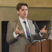 Elias Sacks speaks at a conference