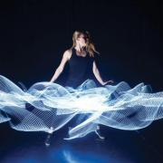 A performer dancing with lights