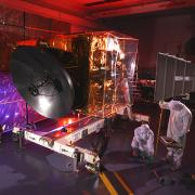 Engineers work on the EMM spacecraft in a cleanroom