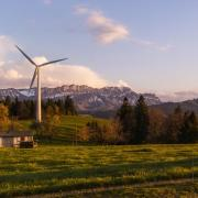 windmill on farm with mountains behind