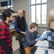 Professor Mike McGehee and students working in the lab. (Photo provided)