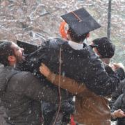 Family celebrates a College of Engineering and Applied Science winter graduate in the snow