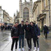 Students pose for a photo in Bath, England