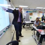 Adam Bradley teaches English class at Montbello High School