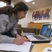Student registers for classes on laptop