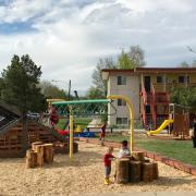 children play at new Kendall Apartments playground