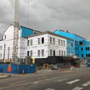 Construction of the new CASE building atop the Euclid Parking Garage