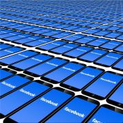 """Series of smartphones with screens reading """"Facebook."""""""