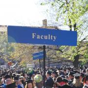 Faculty sign at commencement.