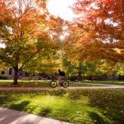 Student rides bike across campus