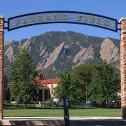 Farrand Field entrance with green field and Flatirons beyond