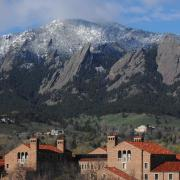 Looking over the roofs of Farrand Hall toward the Flatirons